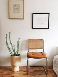 simple framed drawings via sfbybay vine leather and rattan chair white minimal interior