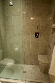 shower stall with corner tiled bench and frameless sliding glass door for small bathroom 16