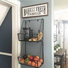 7 hanging produce baskets with sign