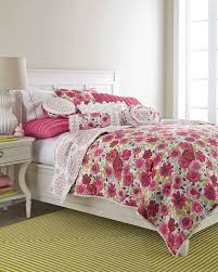 home design bedding. floral quilts and matching shams with pleated trim reverse to a medallion print on this quilt by dena home designs. design bedding