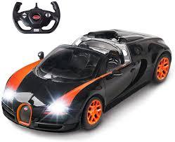 Find used bugatti chiron cars for sale by city. Amazon Com Rastar Bugatti Toy Car 1 14 Bugatti Remote Control Car Bugatti Veyron 16 4 Grand Sport Vitesse Rc Car Black Orange Toys Games