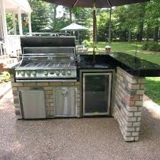 outdoor kitchen kits this l shaped outdoor kitchen features a bar counter sitting area besides the