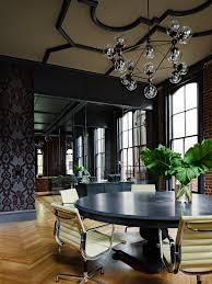 interior design heritage office renovation exposed brick ceiling black chandelier