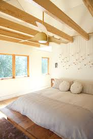 recessed lighting with ceiling fan bedroom contemporary with face pillow wood trim