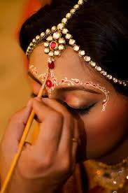 bengali bride with a stylish design of chandan indian bride
