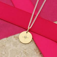 north star solid 9ct gold disc with diamond on a fine silver curb chain