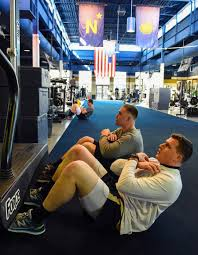 navy football offensive linemen joey gaston and ben tamburello work out in an effort to lose weight preparing to graduate they must conform to the navy s