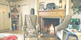 living room decoration with fireplace add wall lamp above oak fireplace mantel decor in rustic living room with grey wingchairs and round side table images