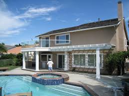 wood patio with pool. Patio Cover White Wooden In Front Of Swimming Pool Wood Patio With Pool