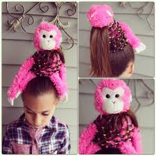 this style would work with any stuffed but the monkey looks pretty cute start with a ponytail and separate the hair around the elastic so you can
