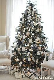 Christmas tree... newspaper covered and glittered balls, those pottery barn  glitter words