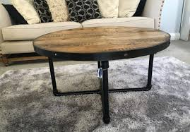 round wood coffee table with pipe legs