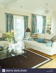 Patterned Curtains For Living Room Patterned Turquoise Curtains And Cream Sofas In Cream Living Room