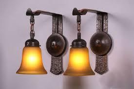 pair gustav stickley hammered copper sconces california historical design