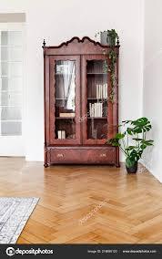monstera plant next dark wooden display cabinet glass doors white stock photo