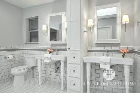 gray walls white trim bathroom white subway tiles with gray glass border trim tiles