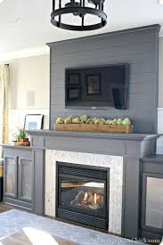 a diy gray fireplace with herringbone tile thriftydecor