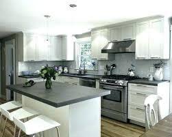 dark gray granite countertops with white cabinets and grey