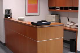 small l shaped reception desk with wall mounted wood cabinet