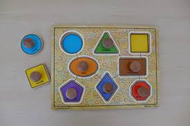 puzzles with wooden knobs make great first puzzles for babies the knobs are easy for little hands to grasp and the shapes are often larger than other