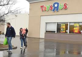 going out of business signs are seen on the toys r us on wolf rd