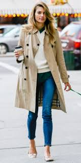 pair trench coat with jeans source whowhatwear