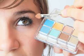 if you have blue eyes woman putting on makeup