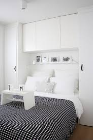 small modern bedroom white. Awesome Grey Quilt On White Bed Inside Small Bedroom With Storage Ideas And Modern A
