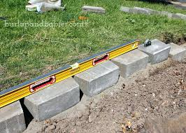 wall level how to build a retaining wall up your curb appeal by building a retaining