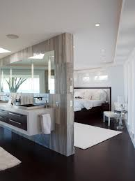 a master suite with matching bathroom and bedroom