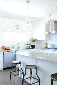 white and gray quartz countertops white and gray kitchen features white shaker cabinets adorned with oil