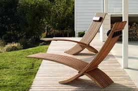 modern patio chairs modern outdoor furniture chic sculptural teak loungers for a modern outdoor space modern modern patio chairs
