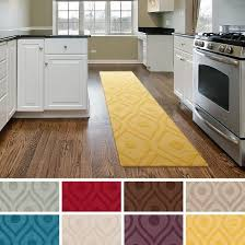 enchanting yellow kitchen rugs with multiple color options on kitchen area beside stove