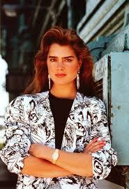 80s hairstyles young brooke shields with brown big dried 80s hair wearing a