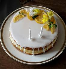 Homemade Lemon Drizzle Cake With Candied Lemons And Flowers Food