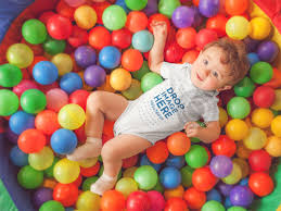 ball pit for babies. pretty baby having fun at a ball pit wearing onesie mockup a14021 for babies