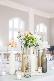 Painted Centerpieces | 7 Wine Bottle Decor Ideas to Steal For Your Vineyard  Wedd.