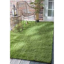 the nuloom artificial grass area rug will look great anywhere you use it from a kid s play space to an outdoor dining area
