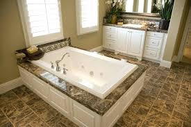 wood soaking tub wide expanse of brown tile flooring matches the marble topped soaking tub enclosure wood soaking tub