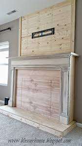 diy faux fireplace with plank wall chimneypiece blesser house featured on remodelaholic