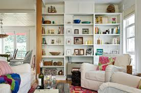 Beach style living room library idea in Portland Maine with white walls