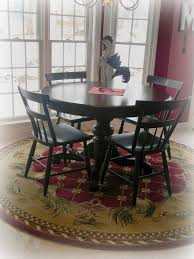 dining room round orted color rug under black wooden table set combined with white