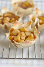 Lay out wonton wrappers, starting with 12 (keep the remaining 12 covered with a damp towel). Apple Pie Wonton Cups Snacks And Sips