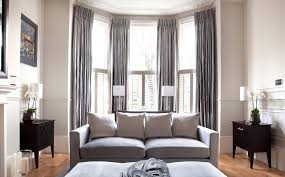 bay windows and grey curtains source swing arm living room curtains