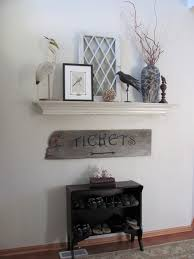 a mantel to decorate and change up with decor but without a fireplace entryway perhaps