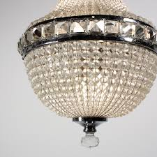 a splendid antique czech crystal four light chandelier circa 1905 the chandelier begins with a loop finial atop a chrome band accented with square crystal