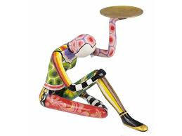 toms drag acrobat sitting sculpture