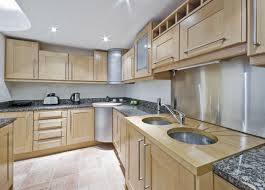kitchen brown wooden kitchen cabinet and black granite countertops also double circle sinks inviting