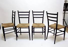 set of four black painted wood ladder back chairs with rush seats the seats are