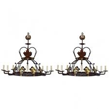 pair of wrought iron and painted metal 8 light chandeliers ul wired